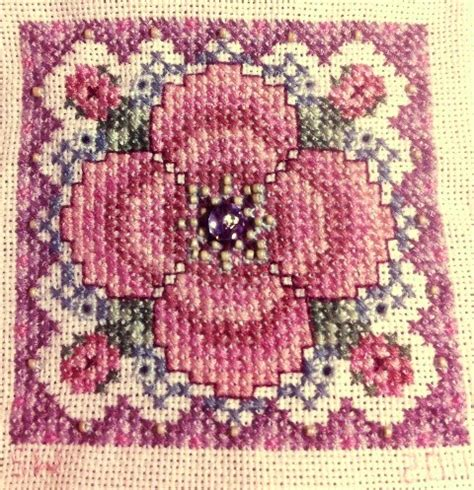 beaded cross stitch lasting on cross stitching