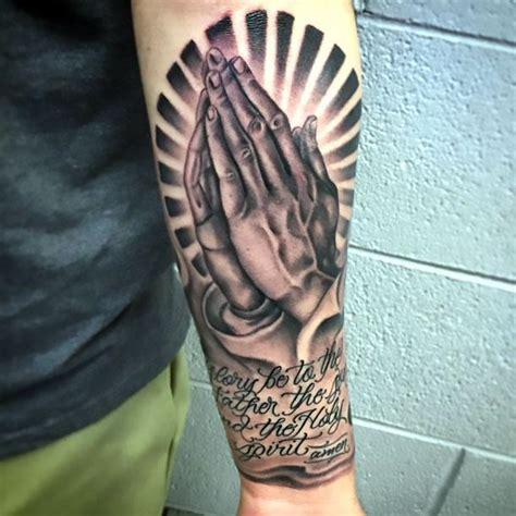 black praying hands tattoo idea