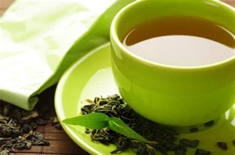 healthy green tea cup with tea leaves   Gudang Ngelmu