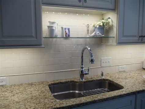 lighting above kitchen sink an idea for sink shelf that won t interfere with new