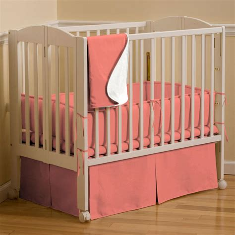 coral crib bedding sets solid coral mini crib bedding carousel designs