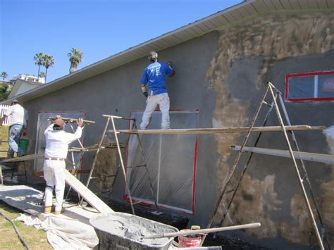 spray painting house exterior paint green button homes