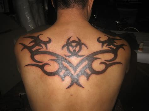 tribal tattoo on man upper back tattooshunt com