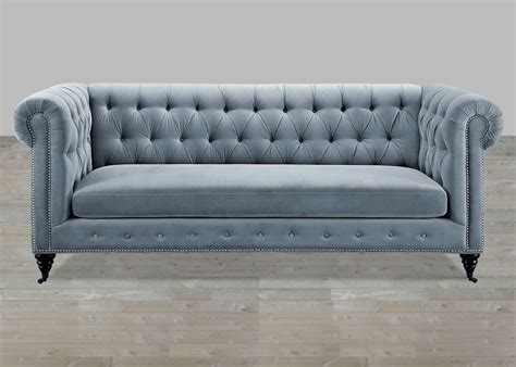 grey velvet sofa button tufted