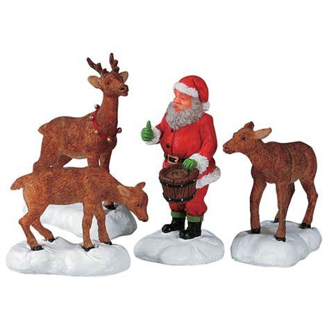 santa and reindeer figurines lemax santa feeds reindeer figurines set of 4 52146