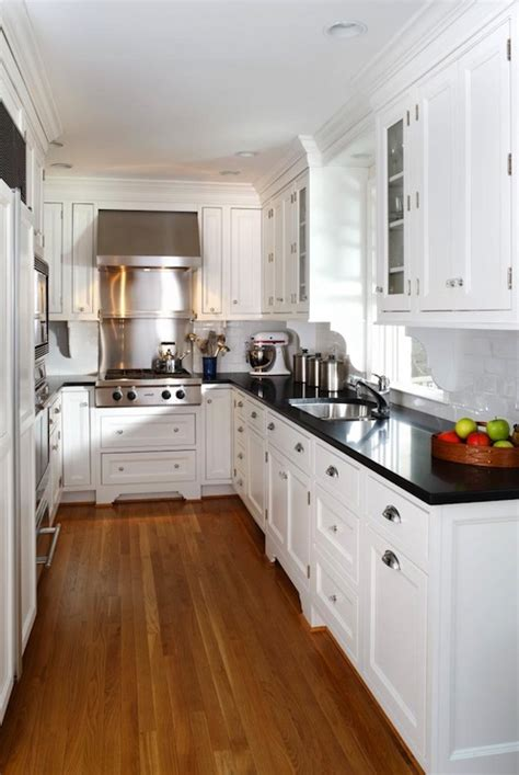 white kitchen cabinets black granite countertops white kitchen cabinets with black countertops