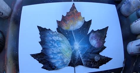 spray paint artist spray painting planets on a leaf bored panda
