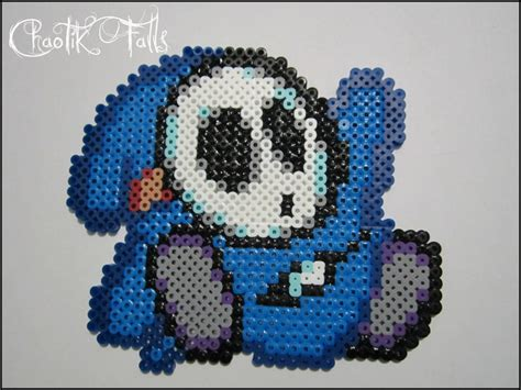 perler bead paper this is pixel made with perler its a blue