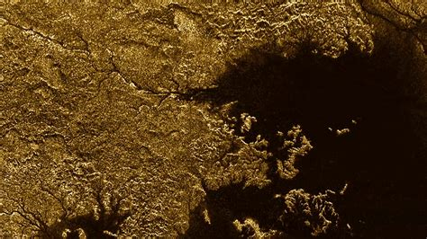 from photos nasa identifies liquid methane on saturn s moon canyons