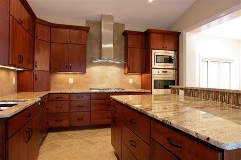cherry kitchen cabinets with granite countertops kitchen with a curved granite countertop island