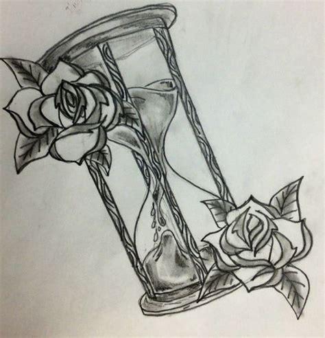 disegno per tattoo clessidra con rose tatuaggi