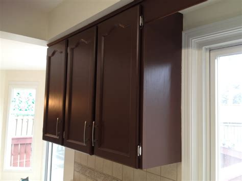 spray painting unfinished cabinets spraying kitchen cabinets