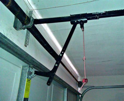 overhead door emergency release garage door opener running but not opening