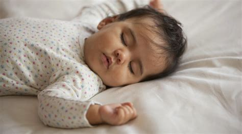 how to get your baby to sleep in a crib how to get your baby to sleep through the