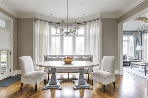 dining room window oval pedestal dining table in bay window transitional