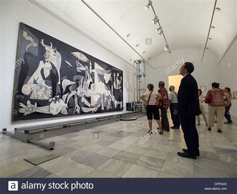 picasso paintings in madrid visitors looking at quot guernica quot painting by pablo picasso