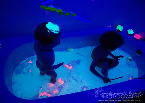 glow in the paint mixed with water black light bath emily weaver brown photography