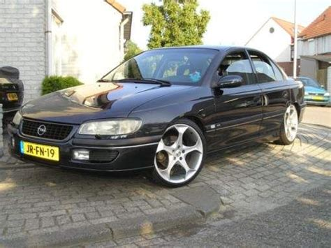 view of opel omega 2 5 td at photos features and
