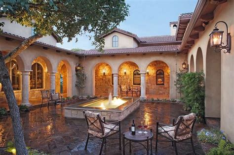 homes with courtyards tuscan style home in atrium courtyard with fascia ideas