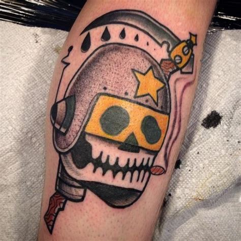arm old skull helmet tattoo by destroy troy tattoos