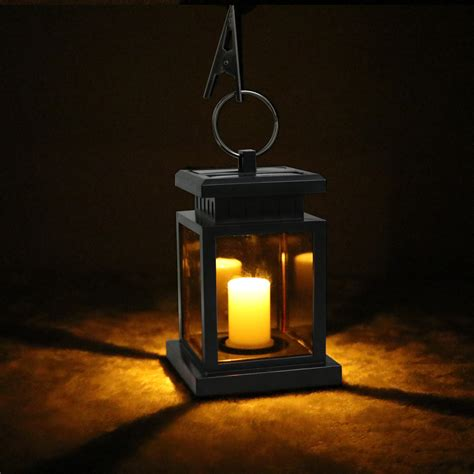 solar hanging lanterns lights outdoor solar power candle lights led c garden outdoor lanterns
