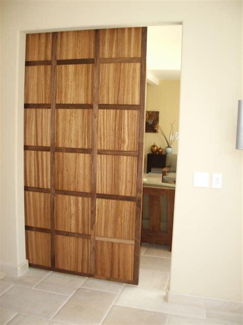 hanging door walnut and zebra wood hanging door contemporary entry