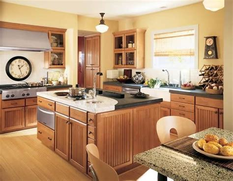 yellow and brown kitchen ideas flooring oak w yellow walls and medium brown cabinets remodel