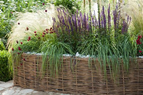 raised garden border ideas a lovely raised bed idea with grasses blood pinks and