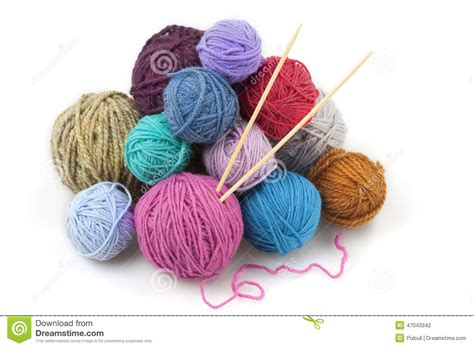 knitting with two colors carrying yarn colored balls of yarn with two knitting needles stock