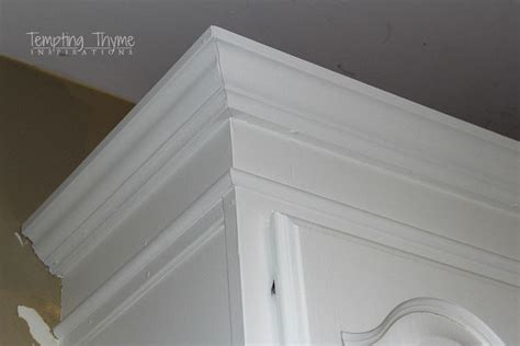 crown molding on kitchen cabinets adding height to the kitchen cabinets tempting thyme