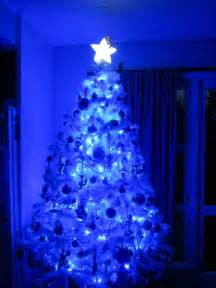 white tree with blue lights gimikd tree