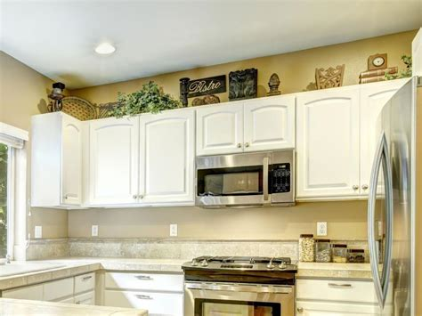 above kitchen cabinet decor ideas gorgeous decorating above kitchen cabinets best 25 above