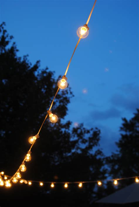 outdoor hanging lights patio how to hang outdoor string lights the deck diaries part