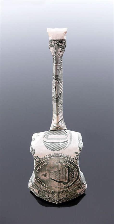 dollar bill origami guitar dollar bill origami cello by craigfoldsfives deviantart
