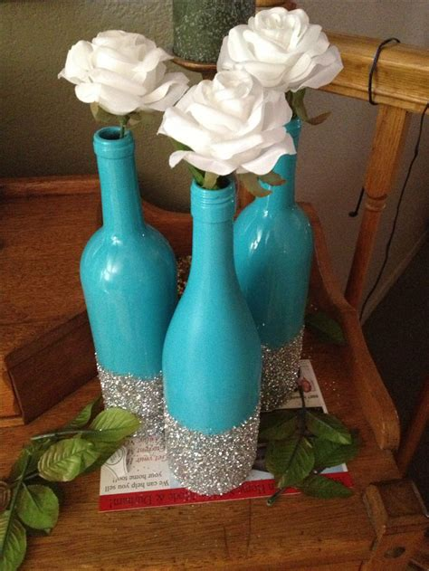 spray painter diy all you need are wine bottles spray paint and glitter