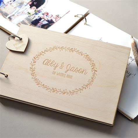 wedding guest book pictures personalised wreath wedding guest book by clouds and