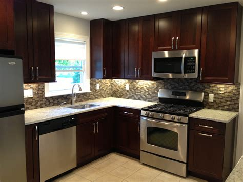 small kitchen with black cabinets cabinets countertop backsplash cabinet handles