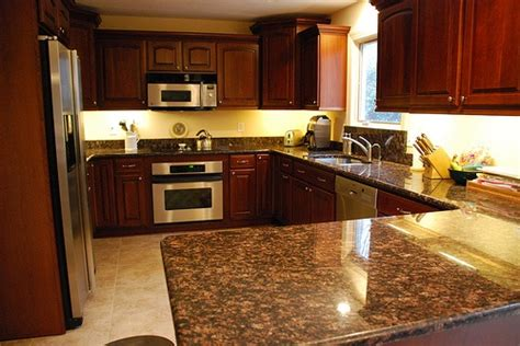 yellow and brown kitchen ideas yellow walls cherry cupboards brown counter floor stainless makes the room look small