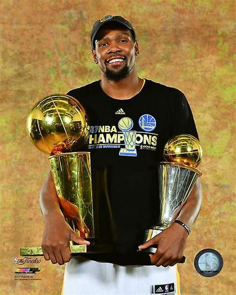 Kevin Durant with the 2017 NBA Championship & MVP Trophies Game 5 of the 2017 NBA Finals Photo