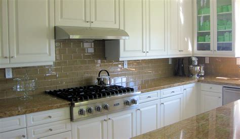kitchen backsplash with cabinets chagne glass subway tile backsplash with white cabinets