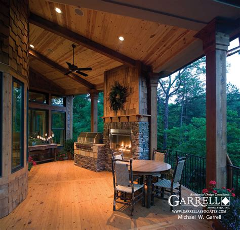 covered porch house plans tranquility luxurious mountain house plan