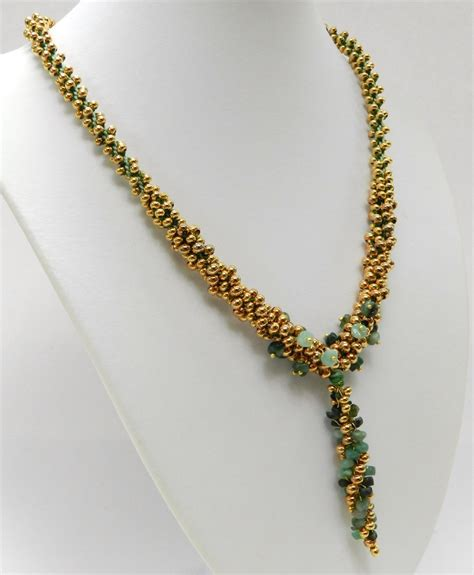 how to make jewelry necklace kumihimo made using metal seed and emeralds