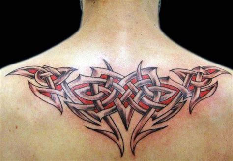 tribal celtic red ink tattoo on man upper back