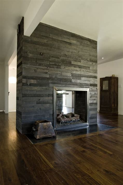 woodworking sided cool grey wood central fireplace