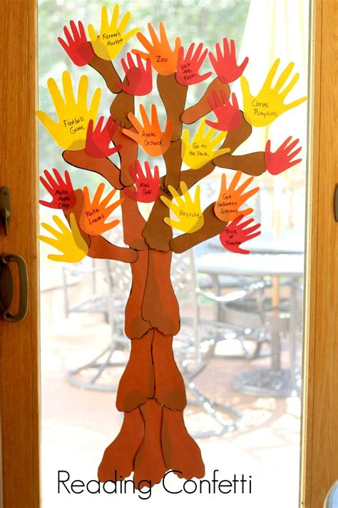 autumn arts and crafts for family handprint and footprint fall tree reading confetti