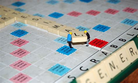 scrabble two player lilliputians at work artist tony davis
