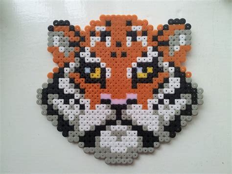 hama tiger pin by esther on strijkkralen