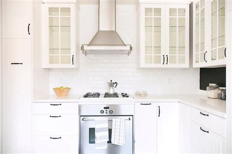 white glass kitchen cabinet doors white beadboard kitchen cabinets with beveled subway