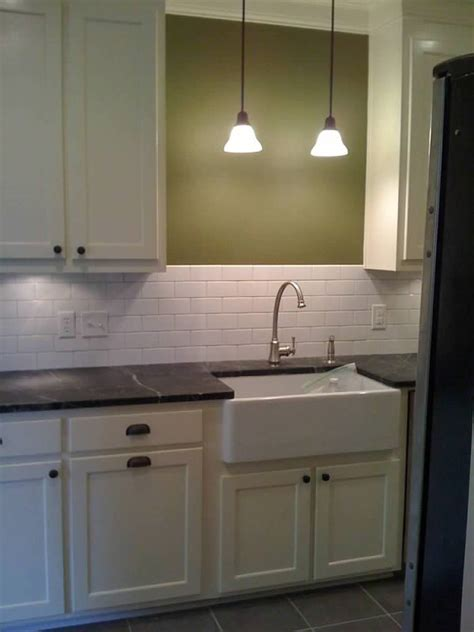 lighting above kitchen sink anyone a pendant light above their kitchen sink