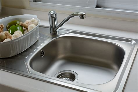 for kitchen sink why does my kitchen sink smell and what should i do